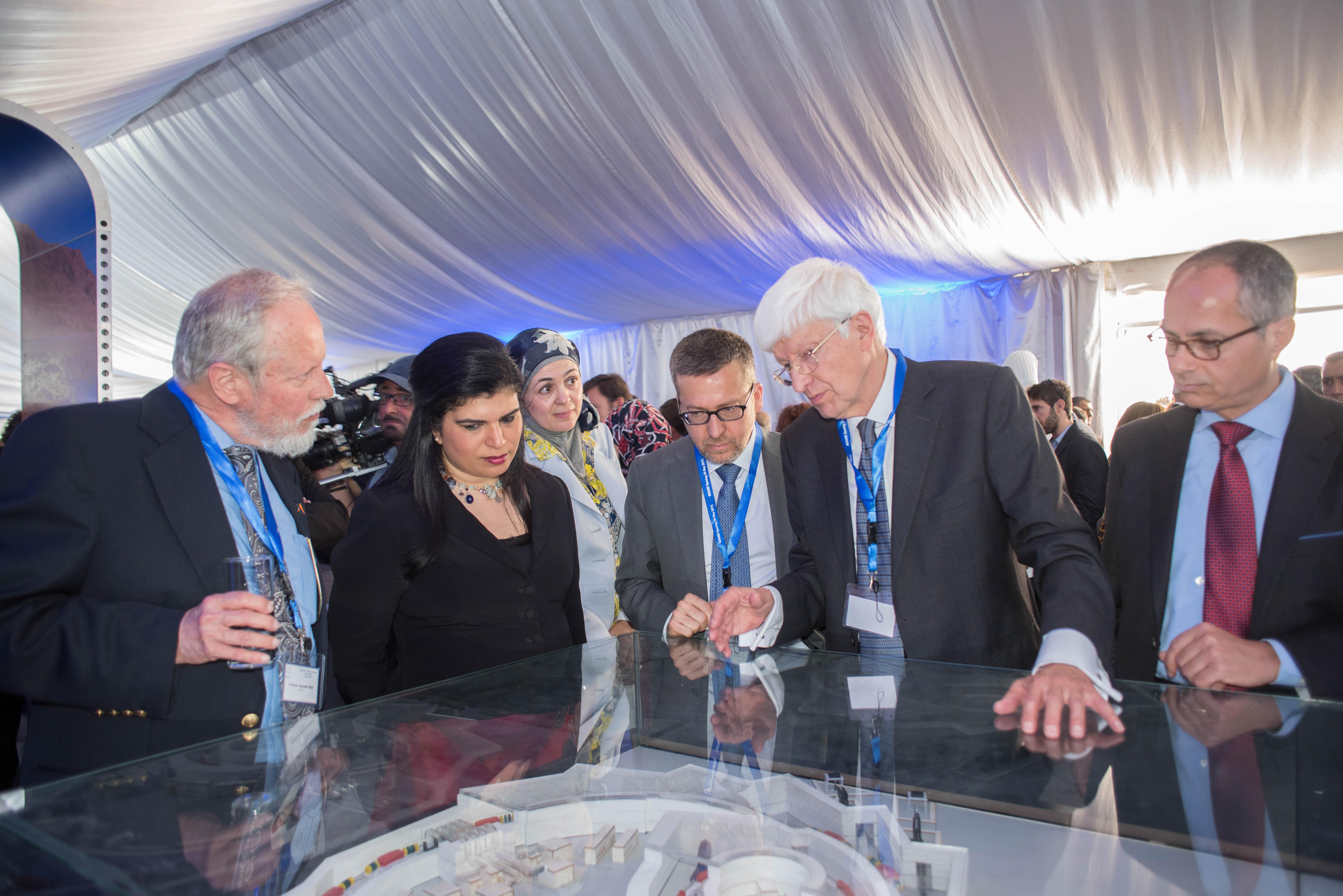© Joe Niemela/ICTP-UNESCO: The President of the Council explaining the model of the SESAME accelerator with (on his right) the EC Commissioner for Research, Science and Innovation and HRH Princess Sumaya bint El Hassan (front)