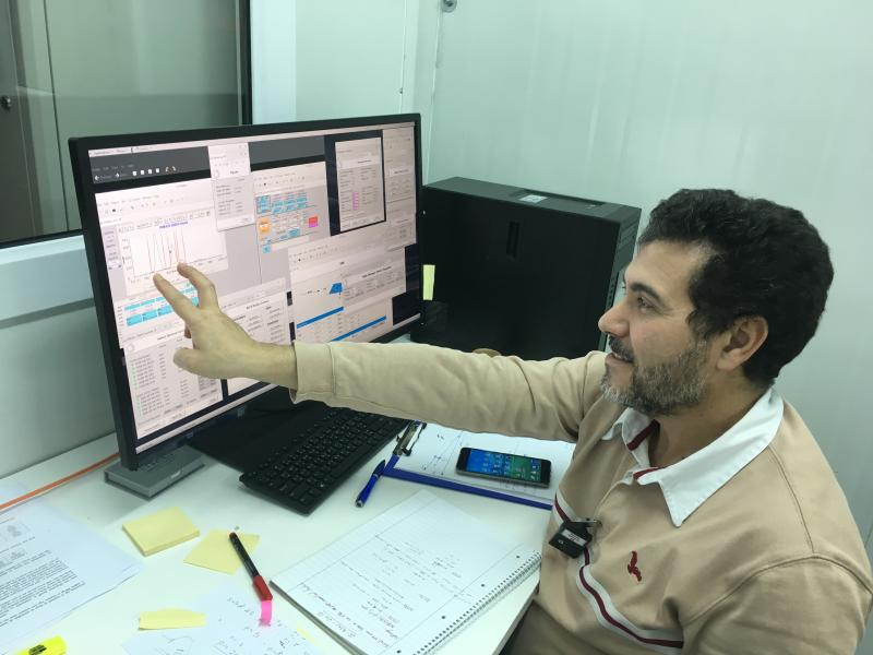 SESAME XAFS/XRF beamline scientist, Messaoud Harfouche, points out SESAME's first monochromatic light
